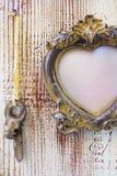 Vintage frame on a wooden background. Vintage frame with hanging keys on a wooden background stock photography