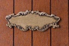 Vintage frame on the wooden background Stock Image