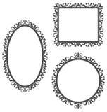 Vintage frames isolated on white. Three black vintage frames in different shapes isolated on white background Stock Photos