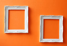 Vintage frames on orange wall Royalty Free Stock Image