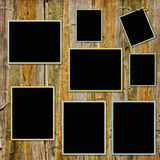 Vintage frames on wooden background Royalty Free Stock Photo