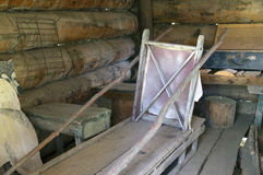 Vintage Freight Dog Sled. A Vintage homemade Freight Dog Sled inside a trappers log cabin in Chetwynd, British Columbia, Canada Museum Stock Photos