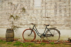 Vintage French Bicycle and Wine Barrel. French Vintage Bicycle and old Wine Barrel against an old wooden structure in Normandy, France Royalty Free Stock Image