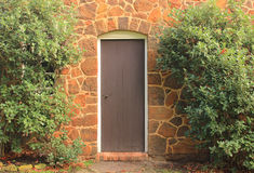 Vintage front door in stone house. The vintage front door of an old stone house Stock Image