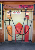 Vintage Fuel pumps and Shell signs at retro gas station. Vintage fuel pumps that advertise and sold Shell economy and Pratts Filtered petrol in the 1920`s/30`s royalty free stock photos