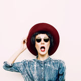 Vintage funny lady in a stylish denim shirt and hat. hipster sty Royalty Free Stock Image