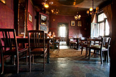 Vintage furniture in a bar in ancient building Royalty Free Stock Photo
