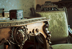 Vintage furniture. Details of vintage room with old furniture, table, chair and wooden case Stock Image