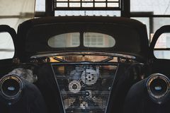 Vintage garage with classic car revive.  Royalty Free Stock Photos