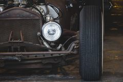 Retro car. Vintage garage with classic car revive Stock Images