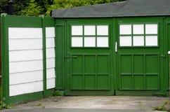 Vintage garage green door Royalty Free Stock Images