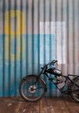 Vintage garage interior with motorbike Royalty Free Stock Photo