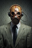 Vintage gas mask and headphones Royalty Free Stock Photos