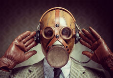 Vintage gas mask and headphones Royalty Free Stock Image