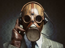 Vintage gas mask and headphones Stock Photos
