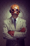 Vintage gas mask and headphones Stock Images