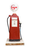 Vintage gas pump. The aged and worn vintage gas pump isolated on white with cliping path Stock Images