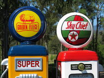Gas pump company logos. Vintage gas pumps with the company logos of Golden Fleece and Sky Chief (Texaco) - on display at an Australian filling station Stock Images