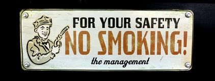 Vintage Gas Station No Smoking Sign. That was posted to warn patrons of danger Stock Photos