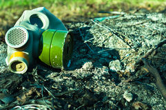 Vintage gasmask. On burnt down ground stock photos