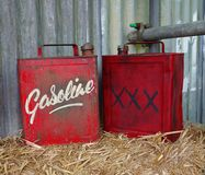 Vintage gasoline cans. Two red vintage gasoline cans Royalty Free Stock Photos