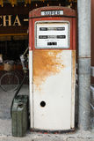 Vintage gasoline pump. An old rusty and vintage gasoline pump which out of service stock photo