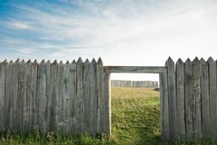 Vintage gateway, ancient city - spiked sticks. Vintage gateway and defense fence, ancient historic area surrounded with spiked sticks royalty free stock image