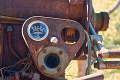 Vintage gauge in forgotten machine. Rusty ampere gauge stares out of long forgotten rusty engine Royalty Free Stock Photography