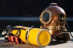 Vintage gear diver. Old antique metal scuba helmet and yellow scuba Stock Photos