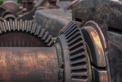 Vintage  gear wheel in colonial factory. Huge vintage  gear wheel in colonial factory Royalty Free Stock Images