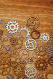 Vintage gear wheels on wooden background Royalty Free Stock Images