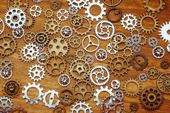 Vintage gear wheels on wooden background Royalty Free Stock Image