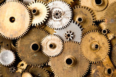 Vintage gears macro view. Aged mechanical clock wheels background. Shallow depth of field, soft focus Royalty Free Stock Images
