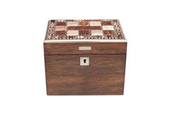 A Vintage General Purpose Wooden Box. A cut-out of a vintage wooden all-pupose box with lock and lid with ornamental tiles for design royalty free stock photo