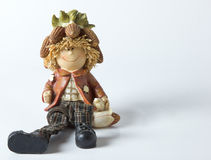 Vintage German toy dwarfs with corn stock images