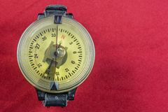 Vintage German WW2 airforce pilot wrist compass on red velvet Royalty Free Stock Photos
