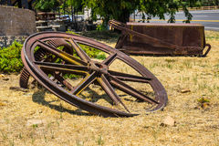 Vintage Giant Mining Wheels & Rusted Mining Ore Cart Carrier. Vintage Giant Mining Wheels & Rusted mine Ore Cart On Ground royalty free stock photos