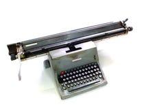 Vintage giant typewriter. Giant heavy duty typewriter isolated on white Royalty Free Stock Photos