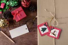 Vintage gift box with blank tag on old wooden background Royalty Free Stock Images
