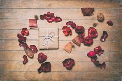 Vintage gift box and decorate petals Royalty Free Stock Photo