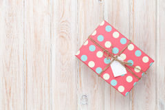 Vintage gift box over white wooden table Royalty Free Stock Images