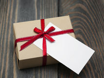 Vintage gift box package with blank  tag Stock Photos