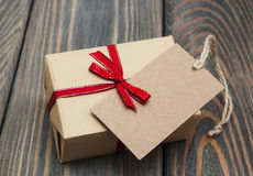 Vintage gift box package with blank  tag Royalty Free Stock Image