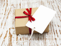 Vintage gift box package with blank  tag Royalty Free Stock Images