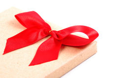 Vintage gift box with red ribbon bow. On white background Stock Photo
