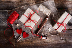 Vintage gift boxes with blank gift tag on old wooden background. Royalty Free Stock Photos