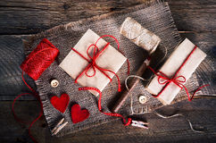 Vintage gift boxes with blank gift tag on old wooden background. Royalty Free Stock Photography
