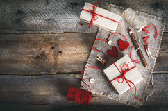Vintage gift boxes with blank gift tag on old wooden background. Royalty Free Stock Images