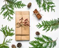 Gift boxes in craft paper on white background. Christmas or other holiday concept, top view, flat lay Stock Image