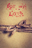 Vintage gift with natural rope in craft paper, closeup. Top view. Love concept or holiday present card stock photos